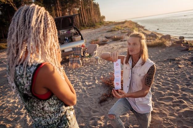 Romantic date. loving boyfriend making very romantic date near the seaside for his appealing girlfriend