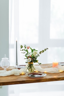 Romantic decorated wooden table with flowers