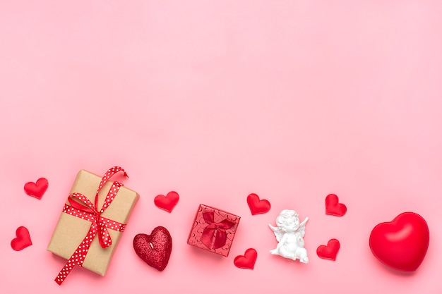 Romantic decoration on pink background top view flat lay happy valentine's day concept