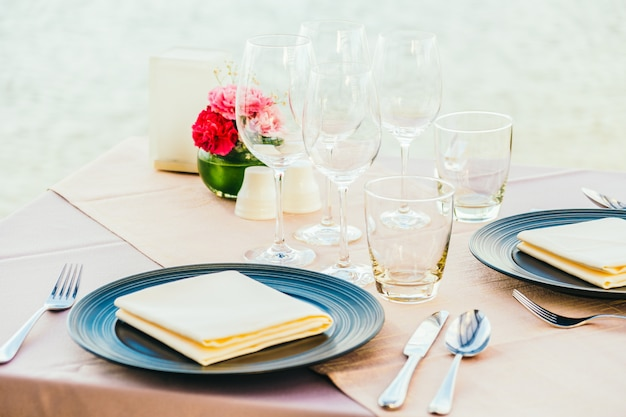 Romantic dining table setting with wine glass and other