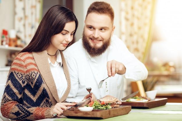 Romantic dinner happy men and women in restaurant