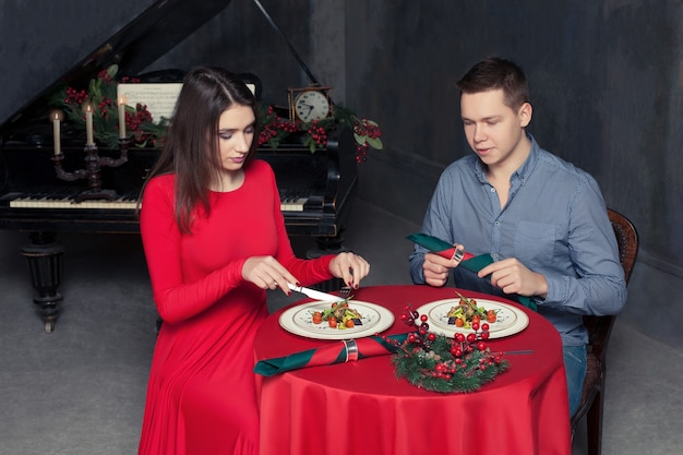 Romantic dinner of young love couple at luxury restaurant.
