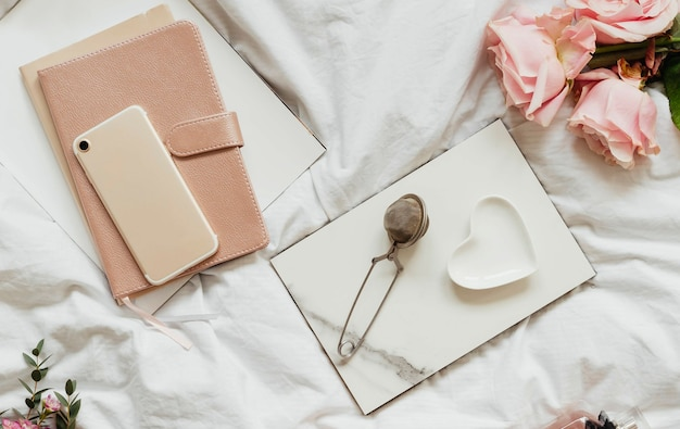 Romantic and feminine flat lay on a bed