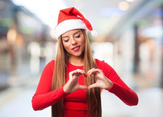 Romantic girl making heart symbol