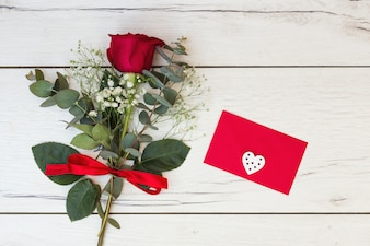 Romantic greeting card with red rose