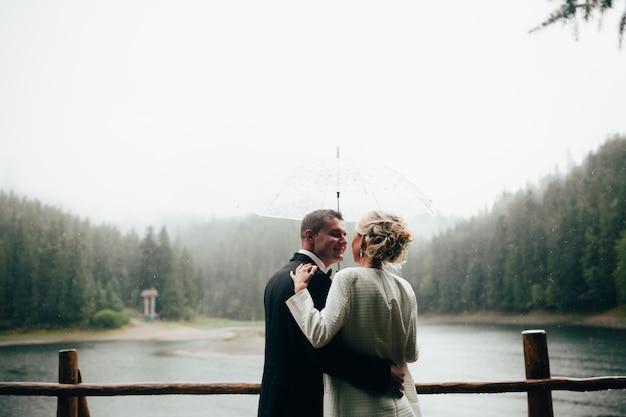 Romantic groom forest yellow bride