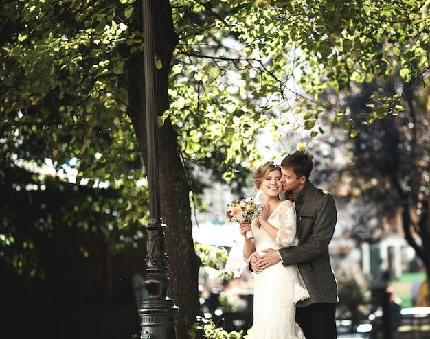 Romantic groom kissing his wife's cheek