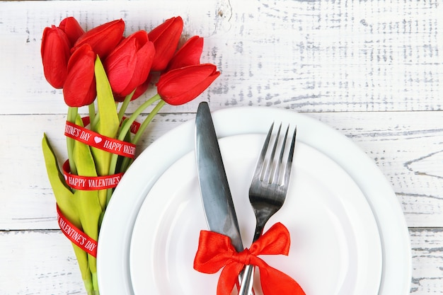 Romantic holiday table setting, on wooden