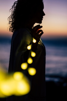 Romantic life concept with standing lady and yellow bulb light