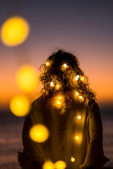 Romantic life concept with standing lady and yellow bulb romance light