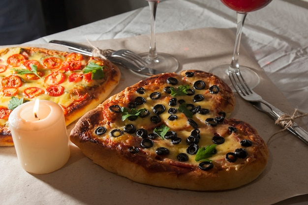 Romantic love heart shaped pizza dinner and giving gifts
