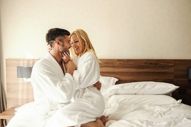 Romantic love of an intimate young couple, foreplay in bed