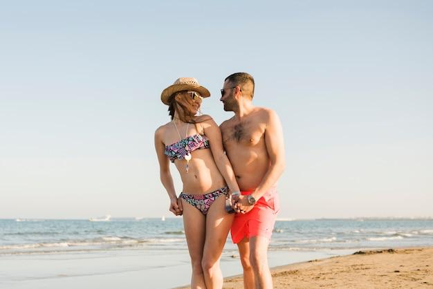 Romantic loving young couple enjoying summer vacation at beach