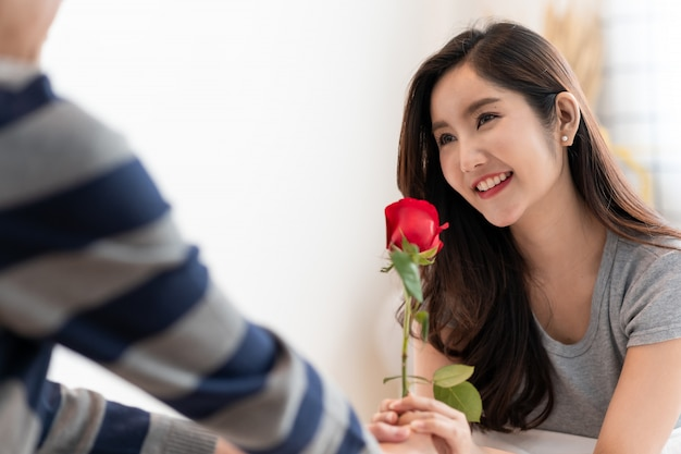 Romantic man giving a rose to beautiful woman