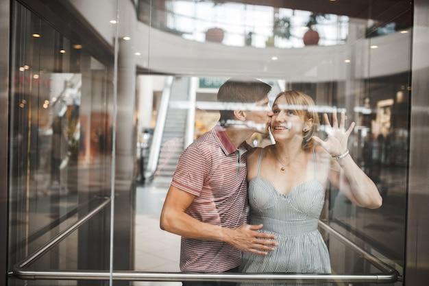 Romantic man kissing his girlfriend in an elevator