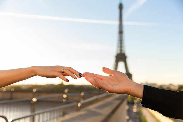 Romantic marriage proposal in paris near eiffel tower