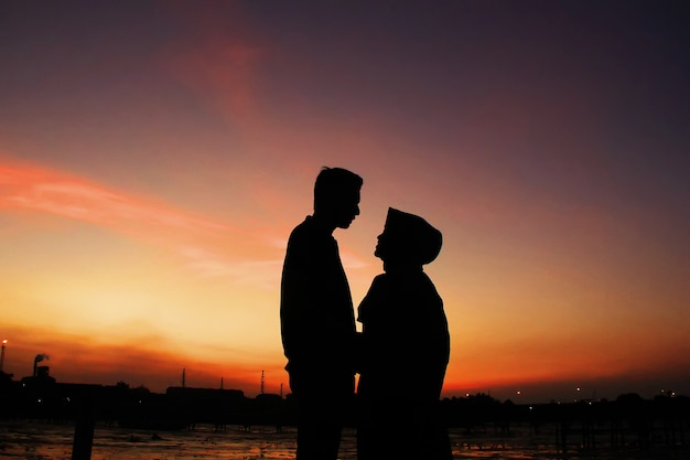 Romantic moments of two couples under the sky with sunset