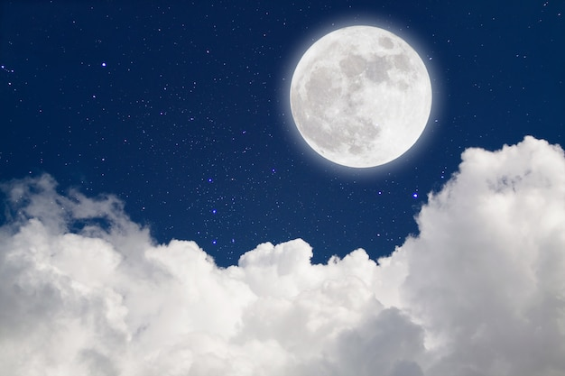 Romantic moon in starry night over clouds.