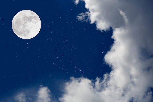 Romantic night. full moon  over cloudscape background.