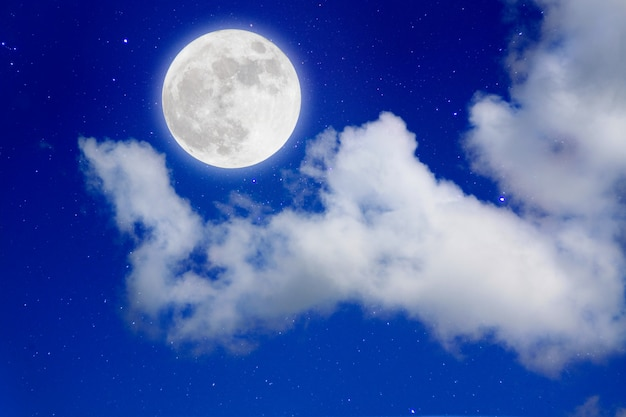 Romantic night.full moon in space over stars with cloudscape background.