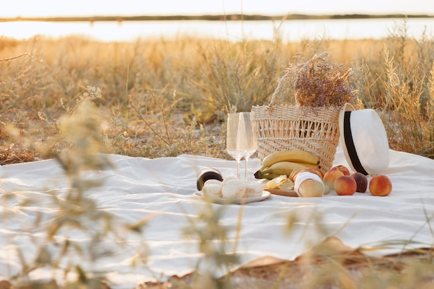 Romantic picnic by the sea for a couple