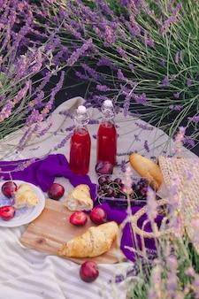 Romantic picnic place at lavender field copy space