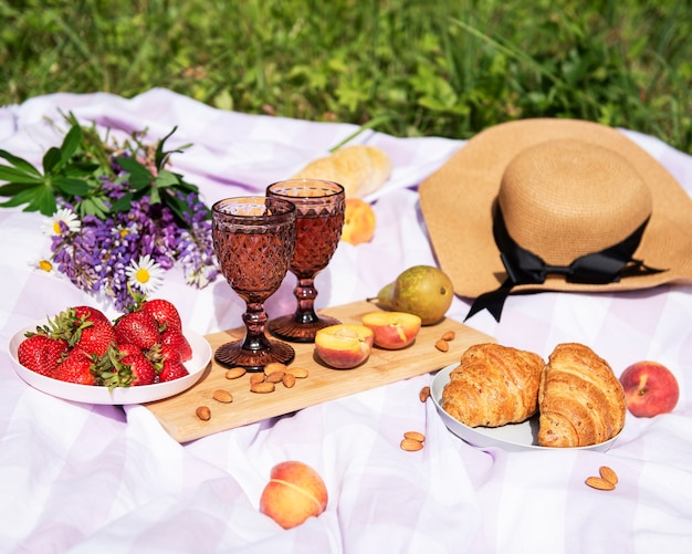 Romantic picnic scene on outdoor picnic with wine and a fruit