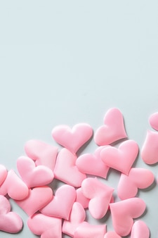 Romantic pink hearts on blue background. valentine's day greeting card with copy space. love concept.
