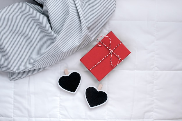 Romantic present in bed. valentine concept