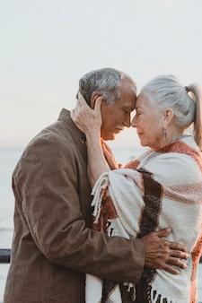 Romantic senior couple by the pier