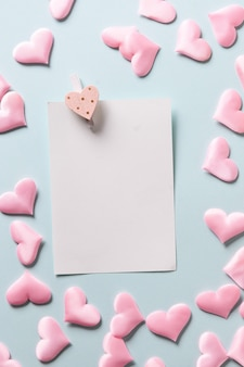 Romantic sheet with pink hearts on blue background, valentine's day greeting card.