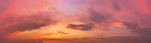 Romantic sky with clouds at sunset. dramatic cloudscape panorama.