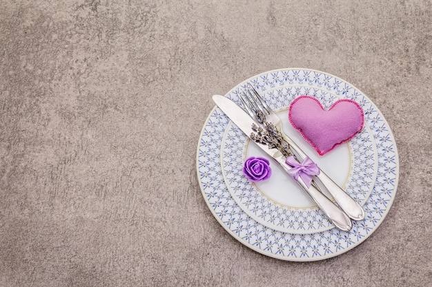 Romantic table setting with felt heart