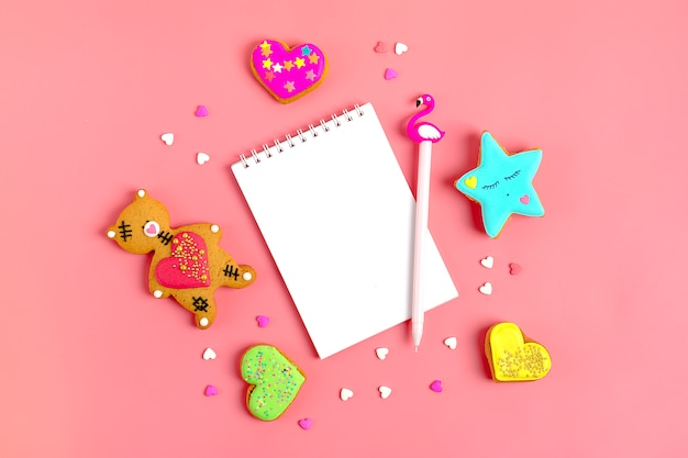 Romantic teddy bear, gingerbread heart, star, notepad on trendy pink background