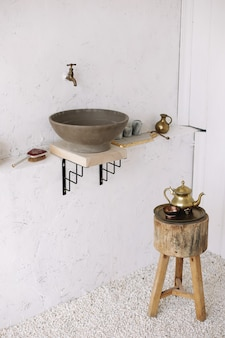 Romantic vintage bathroom interior design in vintage style with wood and concrete