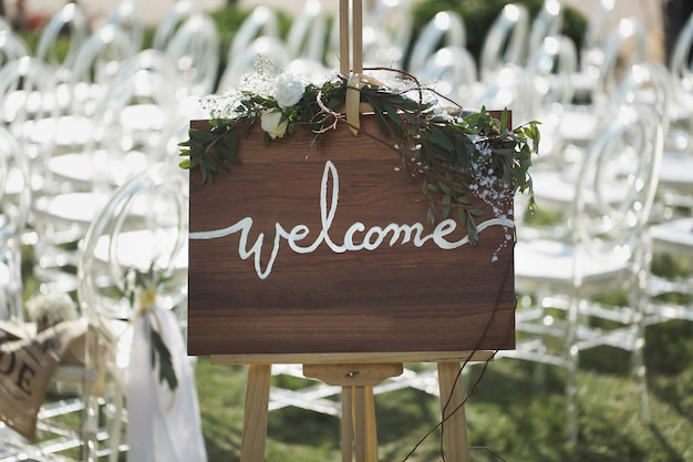 Romantic wedding ceremony on the beach. sign welcome.