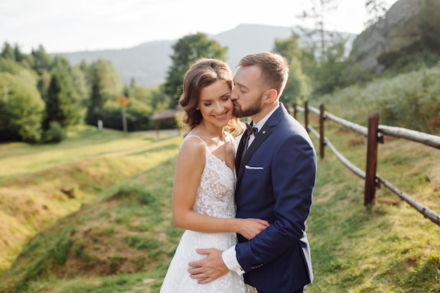 Romantic wedding couple in love walks in the mountains and forest