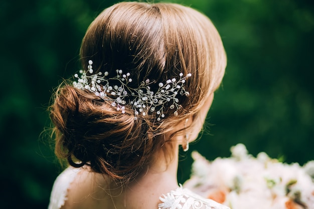 Romantic wedding hairstyle. hair ornament