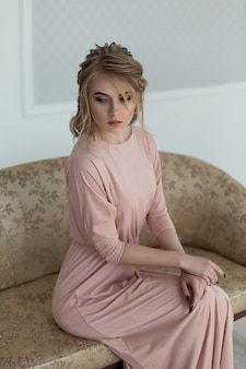 Romantic woman in a pink vintage dress