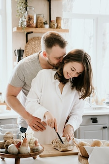 Romantic young couple cooking together in the kitchen