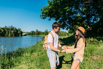 Romantic young couple enjoying outdoor near the lake