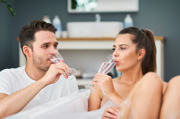 Romantic young couple enjoying and relaxing in the bathtub