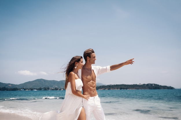 Romantic  young couple  enjoying summer vacation  on the beach.