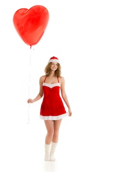 Romantic young woman with a big heart balloon