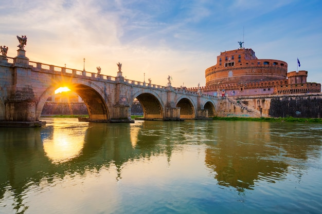 Rome. image of the castle of holy angel and holy angel bridge over the tiber river in rome at sunset.