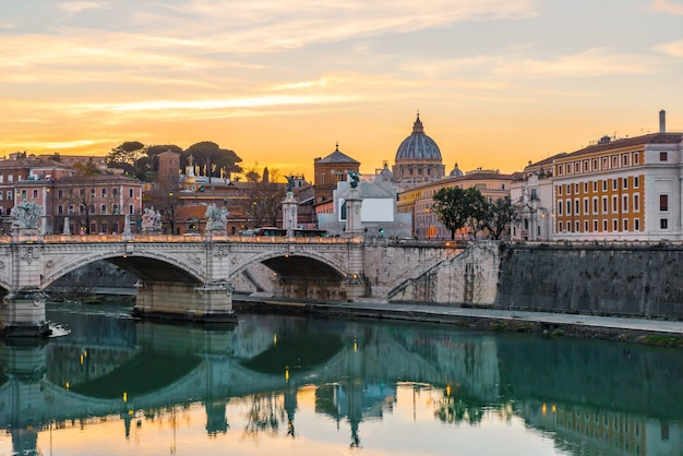 Rome, italy. vatican dome of saint peter basilica or san pietro and sant'angelo bridge over tiber river