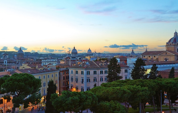 Rome panorama building evening, rome rooftop view with ancient architecture in italy at sunset