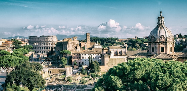 Rome skyline with colosseum and roman forum, italy