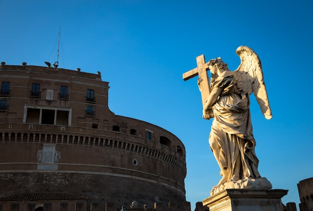 Rome, statue of an angel on the bridge in front of castel sant'angelo. conceptual useful for spirituality, christianity and faith.