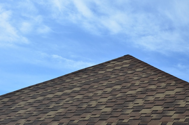 The roof covered with a modern flat bituminous waterproof coating under a blue sky